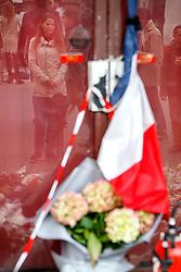 © Licensed to London News Pictures. 16/11/2015. Paris, France. Mourners visit Le Carillon cafe-bar in Paris, France following the Paris terror attacks on Monday, 16 November 2015. Photo credit: Tolga Akmen/LNP