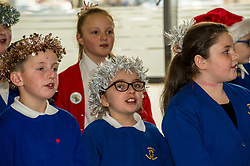 Pictured: John Swinney was greeted by a small choir<br /> Today Deputy First Minister John Swinney visited Niddrie Mill Primary School to announce the publication of Scottish school statistics such as teacher numbers, ratios and class sizes. <br /> <br /> <br /> Ger Harley   EEm 12 December 2017