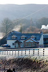 © Licensed to London News Pictures. 18/02/2016. Builth Wells, Powys, Wales, UK. A frosty rural landscape in Mid Wales near the small Welsh market town of Builth Wells, in Powys, Wales, UK after a night with temperatures dropping to - 2 degrees centigrade. Photo credit: Graham M. Lawrence/LNP