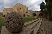 Israel, western Galilee, Acre, The crusaders fort later converted and used by the British as a prison. A cannon ball in the forground