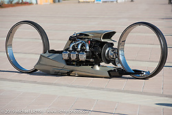 The TMC Dumont double hub-less designed by Tarso Marques of Brazil utilizing a 1964 Rolls Royce Continental 506 cubic inch aircraft was entirely hand fabricated by Tarso's team in his workshop. Photographed on the Daytona Beach boardwalk during Bike Week. FL, USA. Sunday March 18, 2018. Photography ©2018 Michael Lichter.