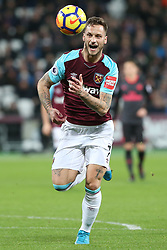 13 December 2017 - Premier League Football - West Ham United v Arsenal - Marko Arnautovic of West Ham pulls a face as he chases down the ball - Photo: Charlotte Wilson / Offside