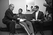 Muhammad Ali In Ireland..1972..14.07.1972..07.14.1972..14th July 1972..A short film on Muhammad Ali in Ireland has been made for showing in the USA before his bout with Al 'Blue'Lewis.The film sponsored by Bord Failte is produced and directed by Mr Louis Marcus.Commentary is provided by Muhammad Ali himself.The project was discussed at Oppermans Country Club Hotel,Kilternan,Co Dublin,where the Ali camp was based...Image of Muhammad Ali listening to Mr Tom Sheehy,Bord Failte.The film Director,Mr Louis Marcus,looks on as the sound recordist,Mr Peter Hunt,Puts away his equipment..
