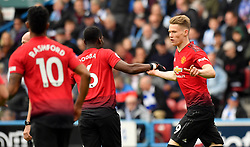 Manchester United's Scott McTominay celebrates scoring his side's first goal of the game during the Premier League match at the John Smith's Stadium, Huddersfield.