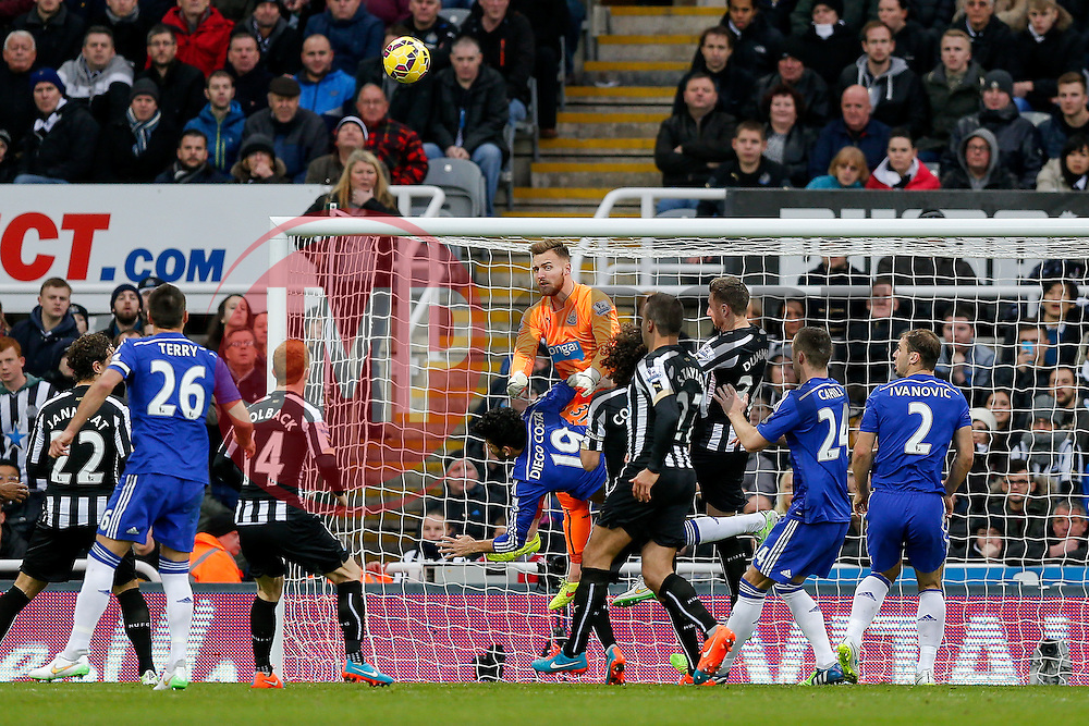 Half Time Replacement Goalkeeper Jak Alnwick of Newcastle United, in his first Premier League appearance, tangles with Diego Costa of Chelsea  - Photo mandatory by-line: Rogan Thomson/JMP - 07966 386802 -06/12/2014 - SPORT - FOOTBALL - Newcastle, England - St James' Park - Newcastle United v Chelsea - Barclays Premier League.