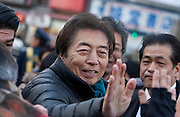 Former Prime-Minsters of Japan, Morihiro Hosokawa high-fives a supporter while campaigning for the 2014 Tokyo Gubernatorial elections in Shibuya, Tokyo, Japan. Friday February 7th 2014