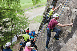 Group of rock climbers scaling a rock face at Oberried climbing garden, Otztal, Tyrol, Austria