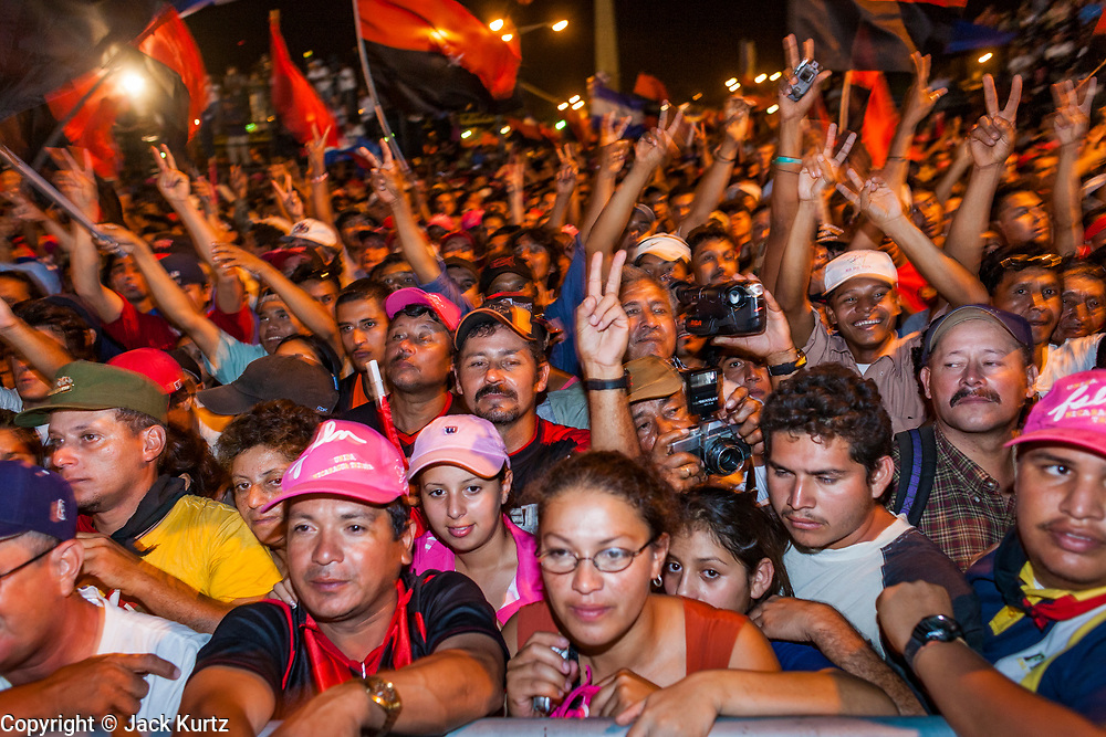 """10 JANUARY 2007 - MANAGUA, NICARAGUA:  People cheer for Daniel Ortega, newly inaugurated President of Nicaragua, at his inauguration. Ortega, the leader of the Sandanista Front, was sworn in as the President of Nicaragua Wednesday. Ortega and the Sandanistas ruled Nicaragua from their victory of """"Tacho"""" Somoza in 1979 until their defeat by Violetta Chamorro in the 1990 election.  Photo by Jack Kurtz"""