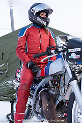 Bene Zaccherini of Italy with her spiked Husqvarna WR 360 outside the pit tent she shared with the French team at the Baikal Mile Ice Speed Festival. Maksimiha, Siberia, Russia. Thursday, February 27, 2020. Photography ©2020 Michael Lichter.