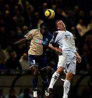 Photo: Jed Wee.<br /> Bolton Wanderers v Marseille. UEFA Cup. 15/02/2006.<br /> <br /> Marseille's Taye Taiwo (L) jumps with Bolton's Kevin Davies.