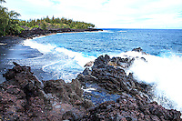 Kalapana Black Sand Beach - The Big Island landscape is always changing, waves crashing into rocky shores and molten lava pouring into the ocean. The Kalapana Black Sand Beach is no exception, with sandy shores that are continuously shaped as crashing waters erode black lava rock. Across 1/4 mile of rocky terrain formed from a 20th century lava flow, you'll make your way across a path to remote Kaimu beach. At the Kalapana Lava Viewing Area, when the volcano is active, emissions are visible as billows of smoke rise above the ocean.