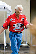 Older man age 66 dancing in beer garden wearing a sporty automobile shirt. Grand Old Day Street Fair St Paul Minnesota USA