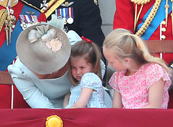 The Duchess of Cambridge supports Princess Charlotte on the balcony of Buckingham Palace, in central London, following the Trooping the Colour ceremony at Horse Guards Parade as the Queen celebrates her official birthday.