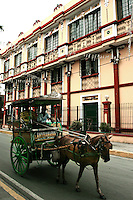 """Calesa or horse and carriage roams the streets of Intramuros.  Intramuros Manila was built by the Spaniards in the 16th century - its name means literally """"within the walls"""" which also describes its structure as it is surrounded by thick walls and moats. During the Spanish colonial period Intramuros was considered to be Manila itself."""