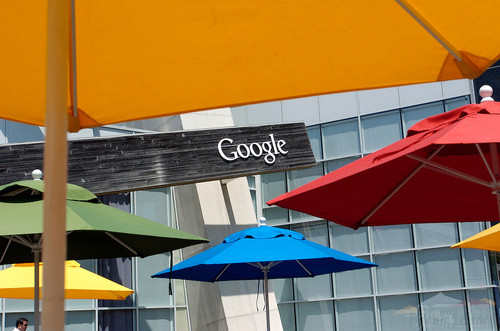 Colorful umbrellas decorate a courtyard at Google Inc. headquarters in Mountain View, Calif., on Wednesday, May 16, 2007. ..PHOTOGRAPHER: Erin Lubin/Bloomberg News.