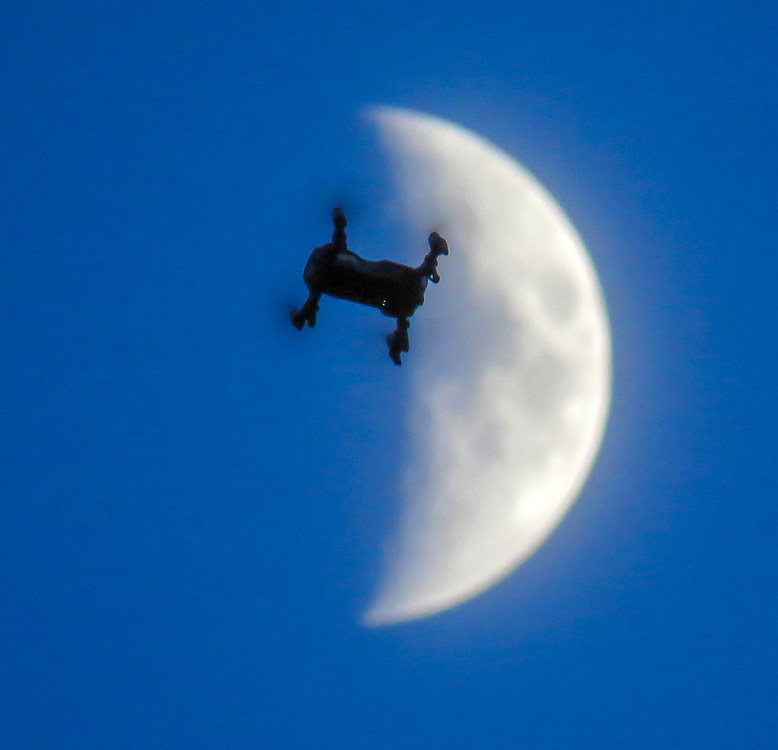 A drone is crossing over the Moon.