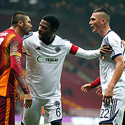 Galatasaray's Burak Yilmaz (L) Kasimpasaspor's Ryan Donk (C) Barıs Başdas (R) during their Turkish Super League soccer match Galatasaray between Kasimpasaspor at the TT Arena at Seyrantepe in Istanbul Turkey on Friday, 31 October 2014. Photo by Kurtulus YILMAZ/TURKPIX