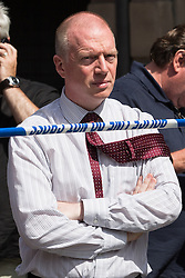 © Licensed to London News Pictures . 14/07/2013 . Manchester , UK . MATT WRACK , General Secretary of the Fire Brigades Union , at the scene today (Sunday 14th July 2013). A fire fighter , identified as Stephen Hunt (38)  is dead and two 15 year old girls are under arrest on suspicion of manslaughter after a blaze in Manchester yesterday (Saturday 13th July) . More than 60 fire fighters tackled a blaze at Paul's Hair World on Oldham Street in Manchester City Centre late in to the night (Saturday 13th July 2013) . Twelve crews from four stations were deployed . Several streets in a block in the city centre are sealed off . Photo credit : Joel Goodman/LNP