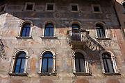 Fresco facades on historic buildings in Piazza Duomo, Trento.
