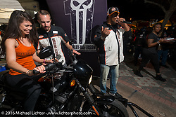 """Alessandra Santos gets help from Tanner Pruett (H-D Consumer Event Marketing) on the Jumpstart bike at the Harley-Davidson display at """"Biking on the Boulevard"""" on Dr. Mary McLeod Bethune Blvd during Daytona Bike Week 75th Anniversary event. FL, USA. Friday March 11, 2016.  Photography ©2016 Michael Lichter."""