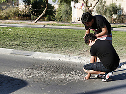© Licensed to London News Pictures 20/11/2012.  Be'er Sheva, Israel.   Israeli children inspect a blast mark from a rocket which hit a bus this morning in the city of Be'er Sheva.  The driver sustained minor injuries but the rest of the passengers remained unharmed.  16 rockets were fired at the city.  A number of houses and a bus were damaged but there were no casualties.  Operation Pillar Cloud has now entered it's seventh day and talks are now underway for a ceasefire.  Later today, UN Secretary General Ban Ki-Moon will land in Israel for a round of meetings to try to broker a cease-fire.   Photo credit : Alison Baskerville/LNP