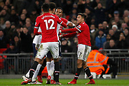 Alexis Sanchez of Manchester United (R) squares up to Delle Alli of Tottenham Hotspur after he is fouled by Alli.  Premier league match, Tottenham Hotspur v Manchester Utd at Wembley Stadium in London on Wednesday 31st January 2018.<br /> pic by Steffan Bowen, Andrew Orchard sports photography.