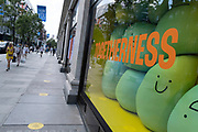 Togetherness sign in the window of Selfridges as some non-essential shops re-open, shoppers return to Oxford Street while social distancing measures are put in place by the various retail shops which are open on 26th June 2020 in London, England, United Kingdom. As the July deadline approaces and government will relax its lockdown rules further, the West End remains quiet, apart from this popular shopping district, which itself has far fewer people on its pavements than normal.