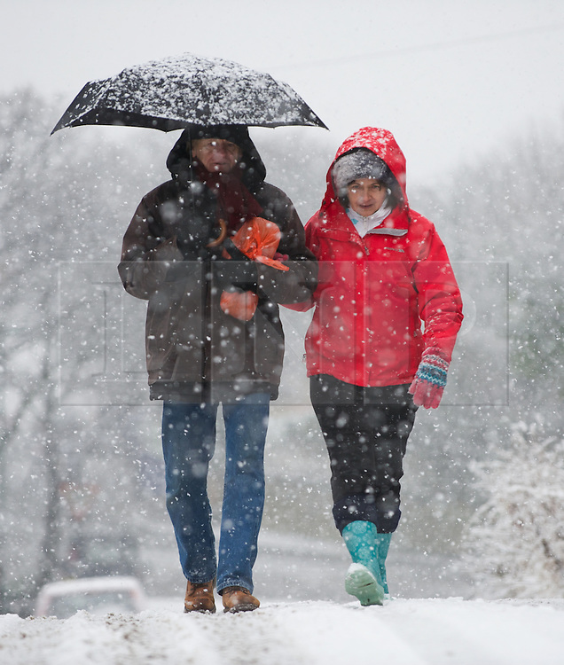 © Licensed to London News Pictures. 14/01/2013..Saltburn, Cleveland, England..A couple walk in heavy snow in Saltburn, Cleveland as parts of North Yorkshire and East Cleveland saw heavy snow fall today.  ..Photo credit : Ian Forsyth/LNP