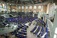 """25 MAR 2020, BERLIN/GERMANY:<br /> Uebersicht Plenarsaal - Um das Abstandsgebot zu beachten, ist nur jder dritte Platz in den Abgeordnentenreihen besetzt, Bundestagsdebatte zu """"COVID 19 - Kreditobergrenzen, Nachtragshaushalt, Wirtschaftsfonds"""", Plenum, Reichstagsgebaeude, Deutscher Bundestag<br /> IMAGE: 20200325-01-034<br /> KEYWORDS: Pandemie, Corona, Sitzung, Debatte, Übersicht"""