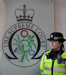 © Licensed to London News Pictures. 05/12/2016. London, UK. A police officer stands outside the Supreme Court in Westminster, London on the first day of a Supreme Court hearing to appeal against a November 3 High Court ruling that Article 50 cannot be triggered without a vote in Parliament. Photo credit: Peter Macdiarmid/LNP