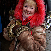 A woman shops in an outdoor market in the northern port city of Arkhangel'sk Russia