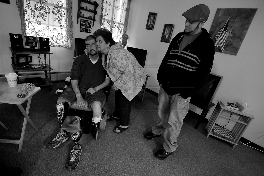 Carlos is visited by his mother and brother Richie who helps Carlos deal with his medical condition.  Carlos Raposa, 49, has lived with diabetes since he was 21 years old. Due to some complications heightened by the disease, Mr. Raposa lost both legs below the knees.  As his condition has worstened over the years Carlos has had greater difficulty dealing with his condition.  Increasingly, Carlos has fallen greater into depression and has turned to smoking and drinking to deal with it.  What used to be monthly visits to the hospital has turned into weekly excursions with ever longer stays in hospital.  Family members have become ever more worried about Carlos' drop in weight and his inability to move on his own any longer.  For someone who was an athletic figure, Carlos has become a shadow of his former self.