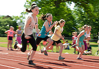 Jewell Simmons, Breanna Richer, Mia Lynch, Carley Cellupica, Kylie Jenn and Makayla Ricks compete in the 100 meter dash during the 5th Grade Track meet with Woodland Heights, Pleasant and Elm Street schools on Wednesday morning.  (Karen Bobotas/for the Laconia Daily Sun)