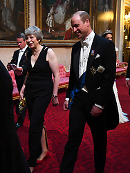 Prime Minister Theresa May and the Duke of Cambridge arrive through the East Gallery during the State Banquet at Buckingham Palace, London, on day one of the US President's three day state visit to the UK.