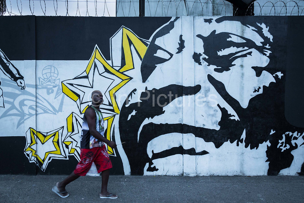 The great Brazilian footballing icon Pele, as a graffiti on a Santos wall, the city where he still lives today as well as the team he played for most of his professional life.