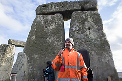 Dan Hooper, better known as roads protester Swampy in the 1990s, addresses over one hundred people, including local residents, climate and land justice activists and pagans, at a Mass Trespass at Stonehenge on 5th December 2020 in Salisbury, United Kingdom. The trespass was organised in protest against the approval by Transport Secretary Grant Shapps of a £1.7bn project for a two-mile tunnel beneath the World Heritage Site and a further eight miles of dual carriageway for the A303, as well as the government's £27bn Road Investment Strategy 2 (RIS2).