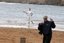 Embargoed to 0001 Monday August 28 A player throws the ball during a match between the Ship Inn Cricket Club and the Eccentric Flamingoes Cricket Club on Sunday April 30th, 2017, in front of the pub in Elie, Fife, which is the only one in Britain to have a cricket team with a pitch on the beach. The Ship Inn Cricket Club season runs from May to September with dates of matches dependent on the tides. Any Batsman who hits a six which lands in the Ship Inn beer garden wins their height in beer and any spectator who catches a six in the beer garden also wins their height in beer.