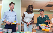 ***EMBARGO 12.01AM Tuesday 17 June.*** © Licensed to London News Pictures. 12/06/2014. Wallington, UK. Lorraine Pascale and Nick Clegg serve their fruit salad to the schoolchildren.  Ahead of an announcement on new food standards for schools, Deputy Prime Minister Nick Clegg and celebrity chef Lorraine Pascale visit Foresters Primary School where they picked fruit with schoolchildren from the school's vegetable patch, prepared a fruit salad, helped the school chefs to serve food and sat with the children as they ate lunch. Photo credit : Stephen Simpson/LNP