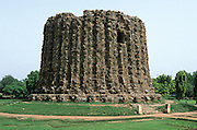 Alau Minar minaret. Construction was stopped on the death of the Sultan,.Alauddin Khilji in 1316, when it was 12m high. It was intended to be higher than its.neighbour, Qutb Minar Minaret, the world's tallest brick minaret. Delhi, India, 2002