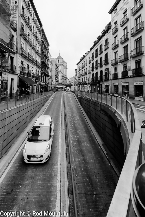 Madrid, Spain - February 15, 2018 - Image taken at Calle de Toledo near Plaza Mayor. Madrid, Spain. <br /> <br /> Image: © Rod Mountain <br /> http://www.rodmountain.com <br /> http://bit.ly/Madrid_bw<br /> Nikon D800 / Nikkor Lens <br /> <br /> @spain @visita_madrid @NikonUSA @nikoncanada @nikoneurope<br /> <br /> @spain.info @visitamadridoficial @NikonUSA @nikoncanada @nikoneurope<br /> <br /> @spain @Visita_Madrid @NikonUSA @nikoncanada @nikoneurope @TurismoMadrid<br /> <br /> https://es.wikipedia.org/wiki/Calle_de_Toledo<br /> https://en.wikipedia.org/wiki/Madrid<br /> https://www.spain.info/en/<br /> <br /> #Spain #TourismSpain #VisitSpain #wonderlust.spain #spain🇪🇸 #Heritage #Architecture #Madrid<br /> <br /> #urbanandstreet#imaginatones #streettogether#streetmagazine #streetview #streetphotographerscommunity #spjstreets#streetizm #noirstreetlife #wearethestreet #traveldeeper #suitcasetravels #letsgosomewhere #travelmemories #cityview #walkabout #travelphoto #travelworld #worldshotz
