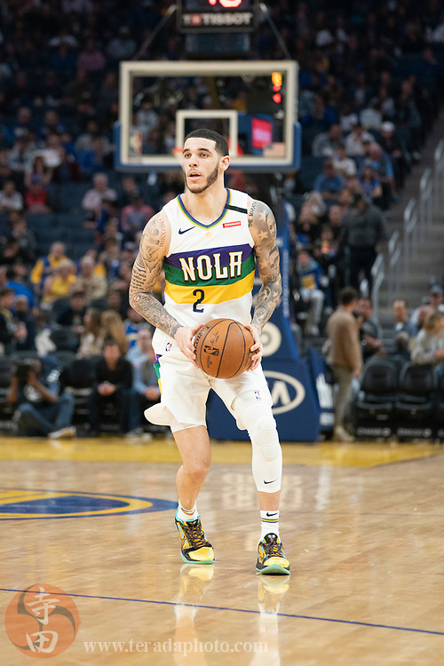 February 23, 2020; San Francisco, California, USA; New Orleans Pelicans guard Lonzo Ball (2) dribbles the basketball during the third quarter against the Golden State Warriors at Chase Center.