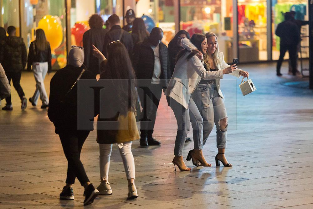 © Licensed to London News Pictures. 22/05/2021. London, UK. Revellers make the most of Saturday night in Leicester Square, central London as easing of lockdown restriction continues. Photo credit: Marcin Nowak/LNP