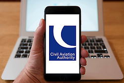 Using iPhone smartphone to display logo of the Civil Aviation Authority.