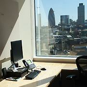 View of cityscape through office glass
