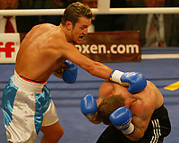 Light Middleweight 6 rounds. Nikita Dubunin (left) from Norway fights against  Petr Rykala (right). Berlin, 17.12.2005. Photo: Miguel Villagran/Witters