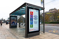 Edinburgh, Scotland, UK. 14 November 2020. Views of Edinburgh city centre on Saturday afternoon during a level 3 lockdown imposed by the Scottish Government;.Pictured; Coronavirus health advisory notices on video displays on bus shelters. Iain Masterton/Alamy Live News.