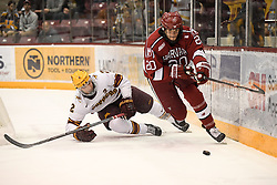 November 17, 2017 - Minneapolis, MN, USA - Minnesota's Jack Sadek (2) falls to the ice as Harvard's Adam Baughman (20) takes control of the puck in the first period on Friday, Nov. 17, 2017, at the 3M Arena at Mariucci in Minneapolis. (Credit Image: © Aaron Lavinsky/TNS via ZUMA Wire)