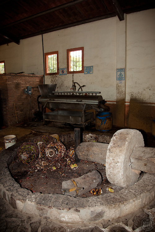 """""""Grinding Agave""""- This stone grinder, called a tahona, is used in the tequila making process.  Photographed at a distillery near Puerto Vallarta, Mexico."""