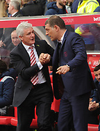 Mark Hughes, the Stoke city manager (l) shakes hands with West Ham manager Slaven Bilic before the game. Premier league match, Stoke City v West Ham Utd at the Bet365 Stadium in Stoke on Trent, Staffs on Saturday 29th April 2017.<br /> pic by Bradley Collyer, Andrew Orchard sports photography.