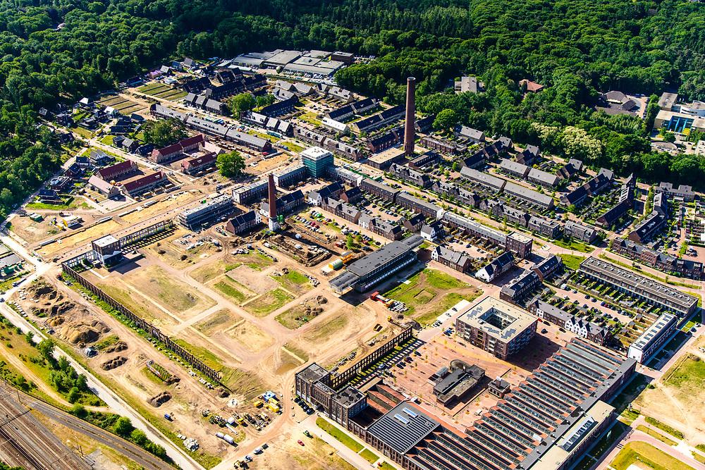 Nederland, Gelderland, Gemeente Ede-Wageningen, 29-05-2019; Ede, Heimanslaan. Voormalige fabrieksterrein van de Nederlandse Kunstzijdefabriek, het  ENKA-terrein van AkzoNobel. Een van de grootste gebouwen van de oude Enka-fabriek huisvest nu De Fietser (showroom, restaurant). Het voormalige industrieterrein wordt getransformeerd tot woonwijk.<br /> Former factory site of the Nederlandse Kunstzijdefabriek, the ENKA of AkzoNobel. The former industrial site is being transformed into a residential area.<br /> <br /> luchtfoto (toeslag op standard tarieven);<br /> aerial photo (additional fee required);<br /> copyright foto/photo Siebe Swart